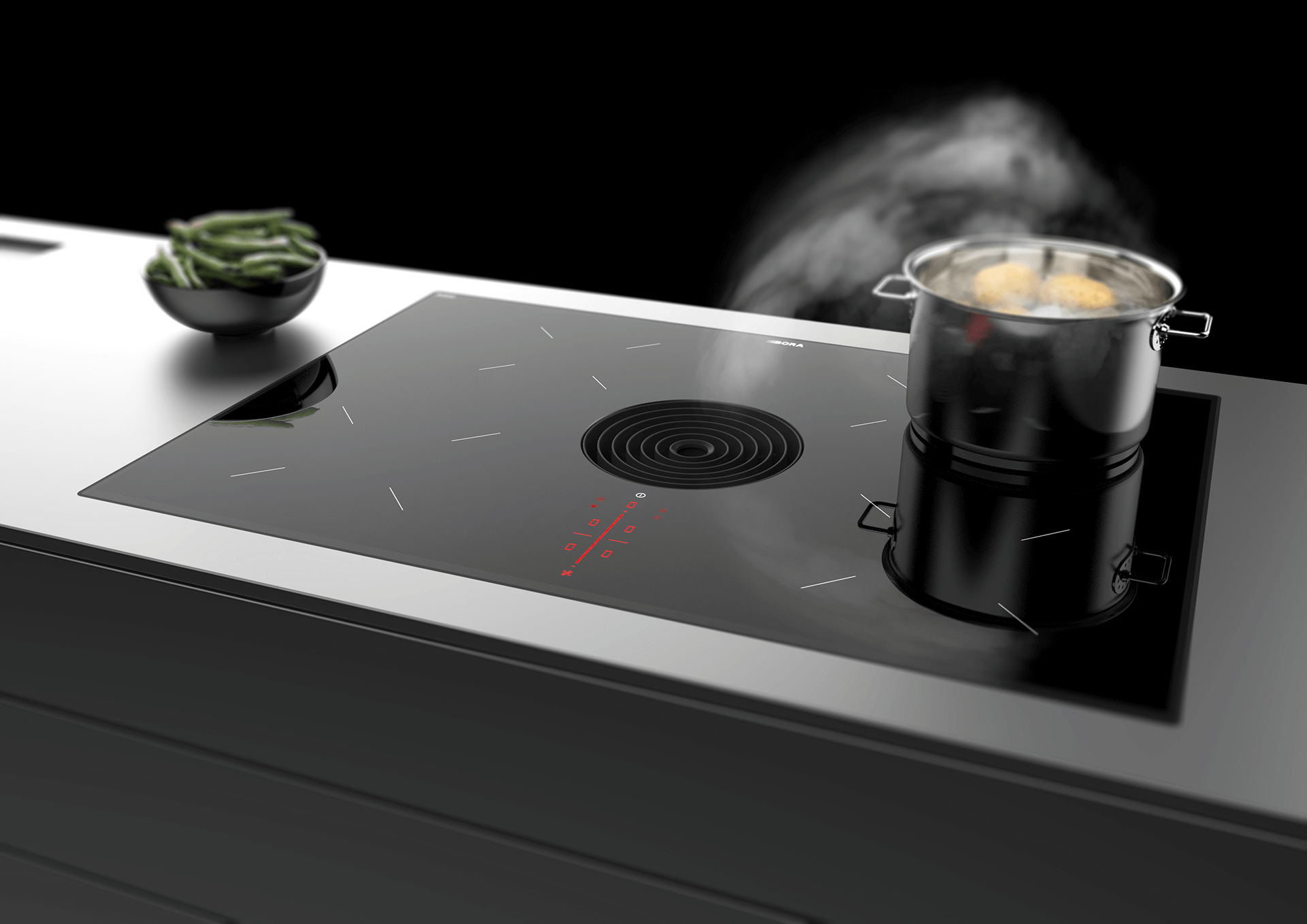 A BORA Pure with a black inlet nozzzle, which absorbs the steam from a boiling pan.