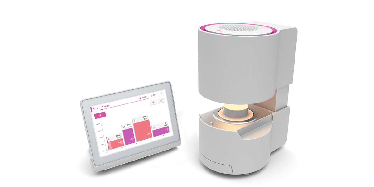 The white-pink oven Smart.Fire from Vita with a glowing lamp is to the left of its associated touchscreen with a light, flat UI.